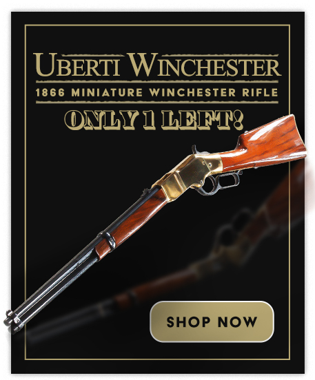 Miniauture Uberti Winchester Rifle against a black background